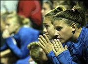 Kansas University soccer players Kim Karfonta, left, and Jessica Smith watch during double overtime of KU's game against Texas. The Jayhawks lost, 3-2, in the semifinals of the Big 12 Conference tournament Friday in San Antonio.