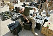 A U.S. Marine from the 1st Division checks ammunition Friday at a base outside Fallujah, Iraq. More than 10,000 U.S. troops have taken positions around the rebel-controlled city of Fallujah, bolstering the U.S. Marine units expected to lead a joint Army-Marine assault there.