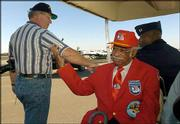 Karl Miller, left, of Manning, S.C., thanks Tuskegee Airman Leroy Bowman for his service to the United States, at the Celebrate Freedom Air & Ground Show at Woodward Airport in Camden, S.C. This year marks the 60th anniversary of the creation of the Tuskegee Airmen, an advanced combat training program for the black airmen at a small Army Air Force base in Walterboro, S.C.