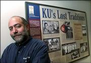 Henry Fortunato, who won a Phoenix Award for Visual Arts, works with the Kansas University History Project. Fortunato is pictured next to one of the many KU history boards he helped bring to fruition inside the Kansas Union.