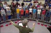 The Lawrence Children's Choir practices under the direction of Janeal Krehbiel on Monday at Southwest Junior High. The choir will perform its fall concert at 5 p.m. Saturday at Grace Episcopal Cathedral in Topeka.