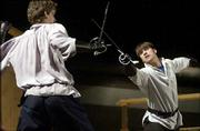 "Cast members of University Theatre&squot;s upcoming production of ""Romeo and Juliet"" fine tune their sword-fighting skills for a brawl scene. The play opens Friday at Crafton-Preyer Theatre."