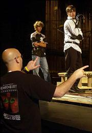 """Nationally noted fight choreographer D.C. Wright gives direction to actors during rehearsal for the upcoming University Theatre production of """"Romeo and Juliet."""" Wright worked with the KU cast several weekends to finalize the play&squot;s fight sequences."""