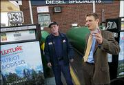 Barry Redmond, left, a pump attendant, chats with Gene Gebolys, president of biodiesel supplier World Energy Alternatives, at the Dennis K. Burke gas station in Chelsea, Mass. Soaring petroleum prices have narrowed the price gap between biodiesel fuel and traditional diesel.
