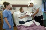 Mary Longacre, Eudora, takes her 1-day-old baby, Alyssa, from