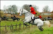 A huntsman riding with the Bicester with Whaddon Chase hunt clears a fence near Stratton Audley, England, Saturday, the first day of the last-ever hunting season. Legislation before Parliament is expected to outlaw hunting with hounds in the near future.
