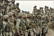 U.S. Marines of the 1st Division line up for a prayer Saturday at their base outside Fallujah, Iraq. More than 10,000 U.S. troops have taken positions around the rebel-controlled city of Fallujah, bolstering the U.S. Marine units expected to lead a joint Army-Marine assault on the city.