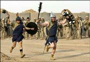 "U.S. Marines of the 1st Division dressed as gladiators stage a chariot race reminiscent of the Charlton Heston movie ""Ben-Hur,"" complete with confiscated Iraqi horses at their base outside Fallujah, Iraq. The Marines preparing to lead an expected attack on insurgent-held Fallujah staged the race as a diversion before their mission."