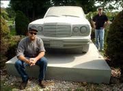 "Mark Sceurman, left, and Mark Moran pose next to a granite replica of a Mercedes-Benz 240 Diesel that serves as a grave marker for Raymond Tse at the Linden Park Cemetery in Linden, N.J. The pair, who publish ""Weird N.J."" magazine and a best-selling book with the same title, have expanded their empire of weirdness to the national level with the book ""Weird U.S."""