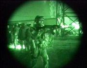 A nightscope image made from Television shows U.S. and Iraqi soldiers outside the hospital in Fallujahl, Iraq. U.S. forces are conducting most of their operations at night, taking advantage of their night-vision equipment.