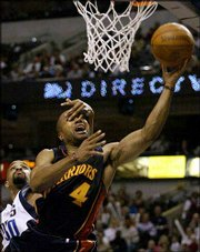 Golden State's Derek Fisher (4) goes to the basket while being fouled by Dallas forward Alan Henderson. The Mavericks won, 101-98, in overtime on Monday in Dallas.