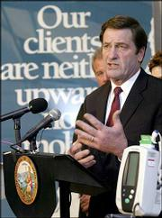 California insurance Commissioner John Garamendi discusses his approval of a $16.4 billion merger between Anthem Inc. and WellPoint Health Networks Inc.'s California subsidiary Blue Cross Life & Health Insurance Co. He made the announcement Tuesday at the Los Angeles Free Clinic.