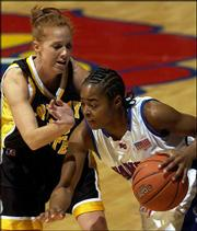 KU's Sharita Smith, right, drives against Fort Hays State's Lindsey Dieterich, of Ottawa.
