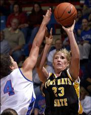 Fort Hays State's Katie Rhodes, a Lawrence native, scores over Kansas' Kaylee Brown in the Tigers' 88-49 exhibition loss to KU. The teams tangled Tuesday in Allen Fieldhouse.