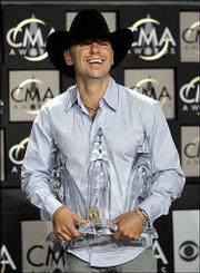 Kenney Chesney took home two trophies at the Country Music Assn. Awards. Chesney took entertainer of the year and album of the year.