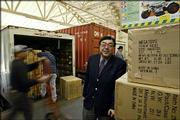 Charlie Woo, Mega Toys chief executive officer, checks his toy warehouse operation in downtown Los Angeles. About 20 percent of the company's holiday merchandise is either on ships or sitting on docks.