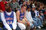 Future Kansas University basketball players Julian Wright, left, Mario Chalmers, second from right, and Micah Downs, far right, watch Late Night in the Phog. The three recruits, pictured Oct. 15 at Allen Fieldhouse, all have signed national letters of intent with the Jayhawks.