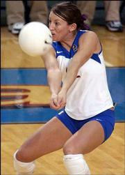 KU's Dani Wittman returns a serve. The Jayhawks swept the Bears, 30-25, 30-23, 30-26, Wednesday night at Horejsi Center.