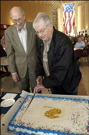 Marvin Metzger, 82, left, and Dale Kearney, 83, both of Lawrence, cut birthday cake in recognition of being the oldest U.S. Marine Corps members in attendance at the 14th annual Lawrence Marine Corps birthday celebration. Wednesday's ceremony at the Dole Institute of Politics celebrated the 229th anniversary of the U.S. Marine Corps.