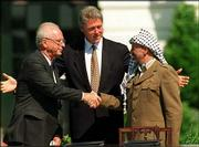 President Clinton presides over White House ceremonies marking the signing of the peace accord between Israel and the Palestinians, with Israeli Prime Minister Yitzhak Rabin, left, and PLO chairman Yasser Arafat, on Sept.13, 1993. Arafat, Rabin and Israeli Foreign Minister Shimon Peres were awarded the Nobel Peace Prize in 1994.