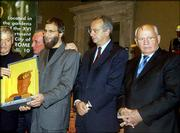 Yusuf Islam, third from right, formerly known as the rock star Cat Stevens, shows the Gorbachev Foundation Man for Peace 2004 award after receiving it from former Soviet President Mikhail Gorbachev, right, and Rome Mayor Walter Veltroni, second from right. Islam received the award before start at the World Summit of Nobel Peace Laureates conference Wednesday in Rome. Men at left are with the Italian chapter of the Gorbachev Foundation.