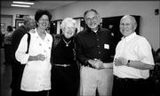 From left are Linda McCoy, Gail Griffin, Tom McCoy and Dave Griffin. They attended the Trinity Episcopal Church Progressive Dinner Oct. 3. The event began with cocktail and hors d'oeuvres at Bishop Seabury Academy.