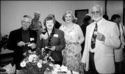 From left are Dick and Rita Tracy, Nora Clark and Allen Wiechert. They attended the Trinity Episcopal Church Progressive Dinner Oct. 3. The event began with cocktail and hors d'oeuvres at Bishop Seabury Academy. After dinners at members' homes, the group gathered at the home of Jerry and Liz Hare for dessert.