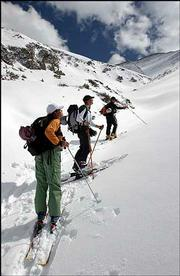 At a brief pause during a high-altitude climb in Loveland Pass in Colorado, Chris Anthony, top, probes the snow with a ski pole to assess stability while Josh Lautenberg, middle, and Kalina Simeonova check the upper peaks.