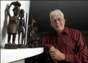Don Conrad, a retired minister who has traveled to Africa with Lutheran World Relief, gives presentations about his trips to make Americans more aware of the problems in African countries. Conrad is pictured with figures collected from his and his parents' travels to Africa.