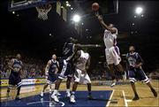 Kansas' Aaron Miles gets airborne against Washburn. Miles finished with 10 points and five assists against the Ichabods.