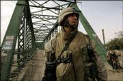 U.S. Marine Maj. Gen. Richard Natonski guards the bridge in the western part of Fallujah, Iraq, where the bodies of two American contractors killed by militants were strung up in March, sparking an earlier U.S. siege. This week, U.S. troops say they're in control of the area.