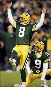 Green Bay kicker Ryan Longwell (8) and holder Bryan Barker react to the game-winning field goal in the final seconds. The Packers knocked off Minnesota, 34-31, Sunday in Green Bay, Wis.