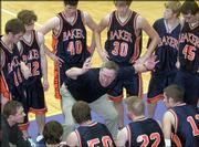 Baker coach Rick Weaver provides instruction during a timeout. The Wildcats defeated Haskell, 93-86 in overtime, Thursday night at Coffin Complex.
