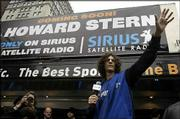 Radio host Howard Stern waves to fans in Union Square in New York. The promotional event Thursday was geared to keep Stern's fans as his show makes the switch to satellite radio.