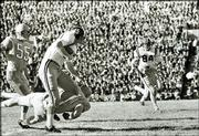 An unidentified Kansas defender tries to tackle Missouri running back Donnie Smith (45) during the 1960 game.