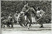 Kansas fullback Doyle schick (30) carries the ball during the Jayhawks' stunning 23-7 win over previously unbeaten Missouri in 1960. MU was later awarded a forfeit victory when KU running back Bert Coan was declared ineligible.