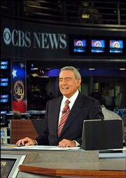"Dan Rather anchors CBS News election night coverage in New York in this photo taken Nov. 2. Rather, whose nearly 24-year tenure as anchor of the ""CBS Evening News with Dan Rather"" was clouded by a recent questionable report on President Bush&squot;s National Guard service, said Tuesday he would step down in March."