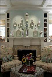 Inspired by Southampton, Lane Elisabeth Oliver decorated her family's living room with robin's-egg-blue paint and floral fabrics. The wood fireplace mantel and brackets display her collection of mercury glass.