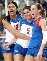 Kansas University volleyball players Josi Lima, left, Ashley Bechard, center, and Jill Dorsey celebrate after Bechard's match-ending point against Colorado. The Jayhawks beat the Buffs, 3-1, Saturday at Horejsi Center.