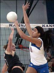 KU junior Josi Lima (10) rejects Colorado's Lara Bossow.