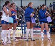 KU volleyball seniors, from left, Ashley Bechard, Jill Dorsey and Ashley Michaels listen as Lindsey Morris, right, gives her senior night speech. The Jayhawks beat Colorado, 3-1, Saturday night at Horejsi Center in their 2004 home finale.