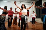 Jamileh Jeanne Handy leads a belly dancing for fitness class in Brunswick, Maine. The ancient form of dance has begun to appear in more health clubs.