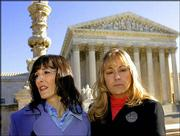 Angel Raich, left, of Oakland, Calif., and Diane Monson, from near Oroville, Calif., leave the U.S. Supreme Court in Washington after the justices heard arguments on their medicinal use of marijuana. Raich, who suffers from an inoperable brain tumor and scoliosis, and Monson, who has a degenerative spine disease, pleaded to the court that they are law-abiding citizens who are seriously ill and need marijuana to survive the pain of their health problems.
