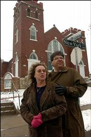 Denise Low and her husband T.F. Pecore Weso have co-authored a book that documents just about every place in the city that was significant to Langston Hughes. They're pictured Tuesday in front of St. Luke AME church, 900 N.Y., the church Hughes attended as a child.
