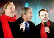 President Bush sings Christmas Carols with Opera singers Carl Tanner, left, and Darren Holden. They sang Thursday during ceremonies for the lighting of the national Christmas tree.