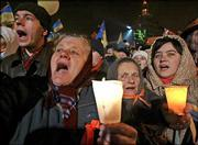 Supporters cheer Viktor Yushchenko as he addresses the crowd at the Independence Square in Kiev. Thousands of upbeat opposition supporters waving Ukrainian flags and wearing orange armbands gathered Thursday in the capital for the 11th straight day.