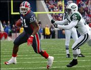 Buffalo running back Willis McGahee (21) eludes New York Jets defender David Barrett. McGahee, shown Nov. 7 in Orchard Park, N.Y., will return to his hometown Sunday for a game against the Miami Dolphins.
