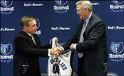 Mike Fratello, left, shakes hands with Jerry West, president of basketball operations for the Memphis Grizzlies. Fratello was introduced Thursday in Memphis, Tenn., as the new head coach of the Grizzlies.