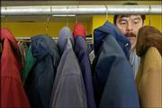 Chico Velasquez, Lawrence, browses through a rack of winter coats at the Salvation Army's annual coat giveaway. Velasquez was one of hundreds of Lawrence residents who took home free coats on Friday.