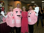 From left, Linda and Scott Robinson, Marci Francisco and Jim Cooper attend Lawrence Memorial Hospital's annual Stepping Out Against Breast Cancer dance at the Lawrence Holidome. About 500 people attended the event Oct. 23.